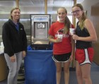 Citizens State Bank in Monticello gave away free ice cream on June 16 in recognition of National Dairy Month. From left are Morgan Stogdill with CSB and hungry customers Kayla Simmons and Piper Hansen. (Photo by Kim Brooks)
