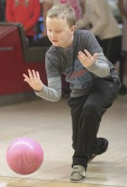 Cole Schmid-McCormick follows through during Sacred Heart bowling.