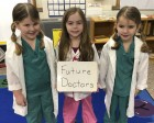These PreK students at Sacred Heart know exactly what they want to be when they grow up! From left are Everly Jaeger, Sophie Meyer, and Poly Jaeger.