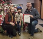 Korbin Bacon, age 5, was the winner of the chamber's bike and helmet giveaway. The helmet was donated by Jones Regional Medical Center. The bike came from McNeill Hardware. Presenting the gifts are Kayla Kurt with JRMC and Chamber board president Mark Spensley. (Photos by Kim Brooks)