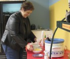 The Monticello Commercial Club sponsored a chili cook-off on Jan. 25. Several businesses to took. Here, Laurie Sperfslage from Anamosa tries the chili at Shine On Gifts & Specialties. Their chili was the overall winner. (Photos by Kim Brooks)