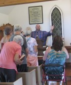 Pastor Frank Shepherd, Jr. with the Scotch Grove Presbyterian Church preached during the church service at the Edinburgh Folk Fest. The historical church building was full of parishioners for the mid-morning service.