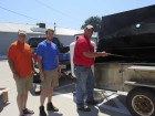 The Jones County Cattlemen assisted F&M Bank at their charity grill-out. From left are Ty Jeffrey, Cole Burrack, and Doug Kurt.