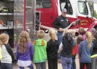 Monticello Firefighter and Training Officer Marv Kelchen visits with students at Shannon School in Monticello for Fire Safety Week, Oct. 8-14. Kelchen introduced the kids about all of the equipment found on a fire truck. (Photo by Kim Brooks)