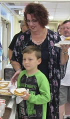 Grandma and grandson Theresa Bacon and Knox Bacon make their way through the breakfast line at Shannon. The gym filled up quickly with many grandparents and grandchildren for the special occasion.