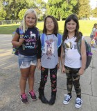 These second-graders were ready for their first day of school at Carpenter Elementary on Aug. 23. From left are Lauren Brunscheen, Nessa Eitel, and Bristol McElmeel. (Photo by Kim Brooks)
