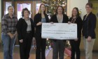 The Monticello Public Library received a $225 donation toward youth programming. From left are Senior Dining Director Lisa Tallman, Early Childhood Iowa Coordinator Sherri Hunt, Deputy Auditor Michele Lubben, Monticello Library Director Michelle Turnis, Deputy Assessor Jane Russell, and Recorder Sheri Jones.