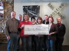 The Jitney Giving Train donated proceeds from their March fundraiser to the Monticello School District Foundation. Karde's C-Store matched the donation for a total of $500. Standing front from left are Foundation Board members Phil Hanna and Megan Brunsheen and Jitney owners Erin Cox and Katie Farrowe. In back are Foundation board members Dan Goodyear, Annette Smith, Chris Brokaw and Winnie Williams. (Photo by Kim Brooks)