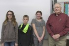 The top three finishers in sixth grade for the KOC spelling bee are, from left, first place, Lauren Kremer; second place, Joe Stoll; third place, Layla Schmit. Far right is Ivan Opperman with KOC.