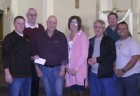 The Monticello Knights of Columbus presented a check to Bob Aldrich on April 15 for the funds raised at the March 10 chili cook off. Aldrich was highly appreciative of the funds. Front row from left are Ryan Sperfslage, Bob and Cathy Aldrich, Roman Manternach, and Rolando Morales. Back row, Ron Buscher and Dean Oswald. (Photo submitted)
