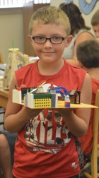 Owen Steger, 8, shows off the model he made out of LEGOs.