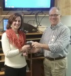On Feb. 20 during the Monticello Lions Club meeting, Vice President Bruce Smith presents a Lions' cups to speaker Stefanie Gogel for her presentation on cochlear implants for the hearing impaired. (Photos submitted)