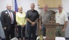 The Monticello Lions Club welcomed two new members at their Sept. 18 meeting. Pastor David Raemisch (third from left) and Craig Lampe (fourth from left) were sworn in as new members by District Governor Jim Bixler (at left). Regena Busch and Bruce Smith will serve as mentors to Raemisch and Lampe. (Photo submitted)