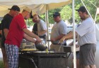 The Monticello firefighters braved the morning heat on July 4 as they prepared for their annual breakfast at the Berndes Center. They offered dine-in and drive-up carry-out options. Making scrabbled eggs are Drew Haag, Alex Green, Billy Norton, and Devin Arduser. In the background helping with carry-outs is TJ Nealson.