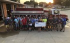 """During Monticello's annual Fourth of July Parade this year, members of the Monticello Fire Department walked the parade route collecting money for MDA (Muscular Dystrophy Association). The """"Fill the Boot"""" campaign raised $2,009 this year. (Photo by Mark Spensley)"""