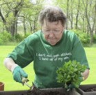 As part of National Skilled Nursing Care Week, MNRC resident Pearl Wittenberg got busy planting flowers to display outside of the center. Wittenberg also helped the other residents with the planting lesson.