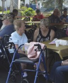 Mary Lorenzen (left) and her niece, Jan Miller, took some time to chat while enjoying the entertainment at the event.