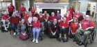 "Feb. 7 was ""Wear Red Day."" Residents and staff at Monticello Nursing and Rehabilitation Center show off their red in honor of heart disease awareness month. (Photo by Kim Brooks)"