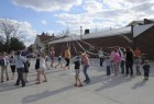 Youth and adults took part in the May Day Pole dance in the parking lot behind the pocket park.