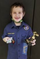 Receiving the Pinewood Derby Turtle Award for slowest car is Weston Rook.