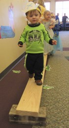Memphis Russ takes a daring walk on the plank above the alligators. This was just one of the many activities the Monticello library put together for the Princess and Pirate Party, March 4.