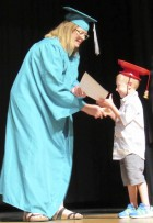 The Monticello preschool classes held a graduation ceremony in the auditorium at Monticello High School on May 17. The teachers, Katie Andrews and Stephanie Zalaznik, shared that the students are ready for kindergarten. Here, Joey Domer receives his diploma from Shannon School Secretary Sandy Hinrichs.