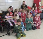Preschool students from Stephanie Zalaznik's class pose for a holiday photo in their best PJs. Also pictured are associates Michelle Liptak and Abby Monk.