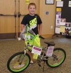 Keegan McElmeel of Monticello was the grand prizewinner in the Monticello library's Summer Reading Program. McElmeel won kid's bicycle and helmet donated by Jones Regional Medical Center. (Photo submitted)