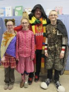 Posing with Sacred Heart Principal Will Spencer on wacky day for Catholic Schools Week is, from left, Emma Althoff, Lelle Rickels, Mr. Spencer, and Dakota Olson.