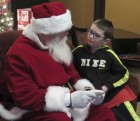 "Wyatt Martin goes over his Christmas list with Santa at Monticello City Hall. The Martin family stopped by to see ""the big guy"" before Christmas. Santa will be on hand Dec. 11 and Dec. 13, 4:30 to 6:30 p.m."