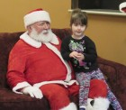 Four-year-old Bella Minnihan sat on Santa's lap and told him of all the toys she wanted for Christmas.