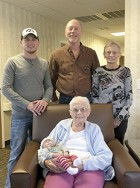 In Front - holding newborn, Kellen Kohl Schenck, is Laura Ambuehl (great-great grandmother). Back Row (left to right) - Mitchel Schenck (father), David Schenck Jr. (grandfather) and Joanne Schenck (great-grandmother)