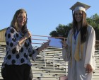 MHS Class of 2020 Co-Valedictorian Emily Schlarmann is recognized by high school Principal Joan Young.