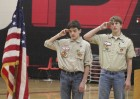 Troop 66 Boy Scouts Zach Chapman (left) and Ben Oswald salute the American Flag during the National Anthem, part of opening ceremonies for the merit badge program Saturday. (Photo by Pete Temple)