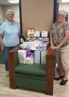 The Royal Neighbors recently donated non-perishable food items and paper products to the Monticello Senior Dining Site. Pictured are Virginia Yossi and Pat Heller. (Photo submitted)
