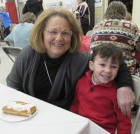 Davis Lyons and his grandma, Mary Lyons, are all smiles as they have breakfast together.