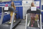2017 GJCF royalty take a turn on the treadmills at the JRMC marathon booth inside the Berndes Center at the fair. From left is Queen Shay Stephen and Princess Lauren Von Behren. (Photo by Kim Brooks)