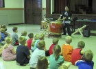 Tanis Sotelo with the Japan America Society of Iowa, based in Des Moines, demonstrated Taiko, Japanese traditional drums, to a crowd. The Friends of the Library sponsored Sotelo's visit as part of the Summer Reading program. The day also included the Art of Iaido and Kendo, Japanese martial arts derived from Samurai Swordsmanship. (Photo by Kim Brooks)