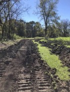 The Monticello trail project is underway as city crews worked to clear brush and help establish the path of the trail last week. The trail will be near the Baty Disc Golf Course and span from E. Oak Street/Highway 38 to E. First Street. This photo was taken near the new E. First Street Bridge looking south. (Photo courtesy of Monticello Parks and Rec)