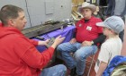 Josef Naab of Monticello gets a lesson in electric train operation from the experts: Monticello Railroad Club members Jared Lasley and Denny Beasley.