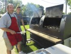 Army veteran Marty Neofotist of Monticello and his son Noah volunteered their time to grill for the Jones County Veterans Annual Open House on June 20. Neofotist served from 1997-2004.