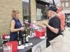 Nick and Julie Sauser of Monticello try some samples of wine from Erin Cox with The Jitney, a downtown Monticello business.