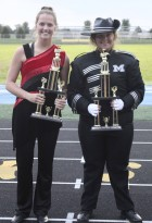 Monticello Marching Band drum majors Rileigh Lambert (left) and Olivia Goodyear display the trophies the band earned at the Wilton Festival of Bands Saturday, Oct. 7. (Photo by Pete Temple)
