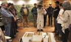 Joe Wagner (center) displays the attire and equipment needed for beekeeping.