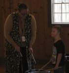 Lucas Hollis of West Delaware (right) enjoys playing drums with teacher associate Kaylee Ambundo.