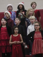 Fourth-graders perform at the Carpenter concert. Among them, first row from left: Zoe Lagunes and Koye Jaeger. Second row: Bonnie Tran, Kyle Arduser and Roth Schnoor. Third row: Grant Gassman and Destiny Wall. Fourth row: Owen Boring, Naryah Trenkamp and Lily Wright.