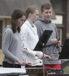 Middle school percussionists (from left) Lauren Koehler, Claire Hogan and Kaden McAtee follow the music.