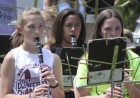 Clarinet players (from left) Nora Sperfslage, Aveeon Drake and Katie Roher perform on a sunny day at the Regions Bank lawn.