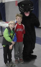The Panther paid a visit to Elementary Family Night, posing with Holden (left) and Griffin Brokaw.