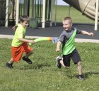 Bryce Fore (left) chases Mason McAtee in a game of tag during Shannon's Fun Day. Both are first-graders.